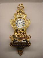94. Часы с консолью. Стиль Буль. 1830 г. 122x46x25 см. Цена 6500 евро