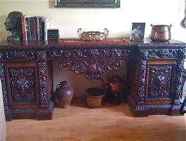 57. Антикварный резной письменный стол. Около 1850 г. Цена 5000 евро.